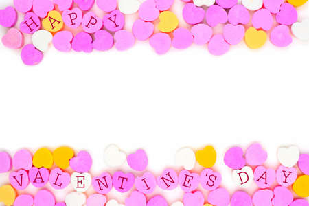 candy border: Pastel colored candy hearts with Happy Valentines Day text forming a double border over white