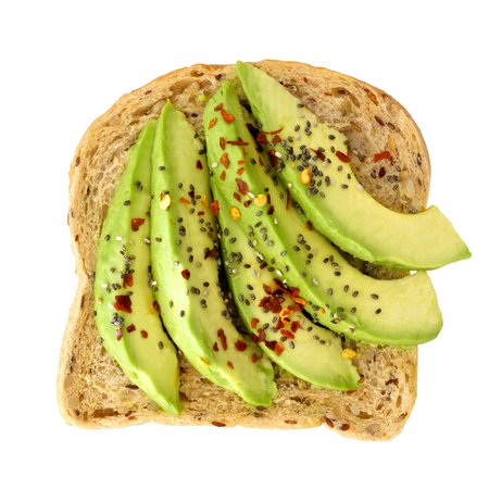Open avocado sandwich with chia seeds and seasoning on whole grain bread isolated on a white background 版權商用圖片