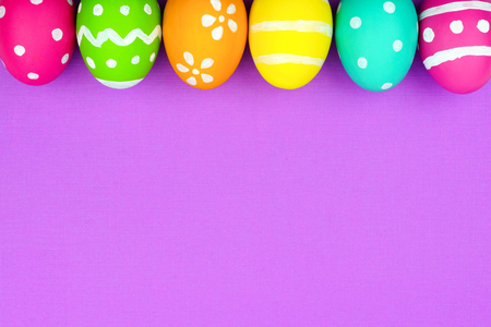 blue background: Colorful Easter egg top border over a soft purple paper background