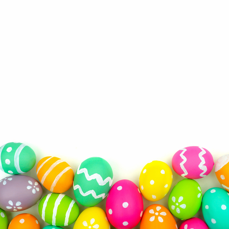Colorful Easter egg bottom border against a white background