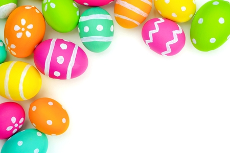 easter decorations: Colorful Easter egg top corner border against a white background Stock Photo