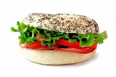turkey bacon: BLT sandwich on a bagel with turkey bacon isolated on a white background