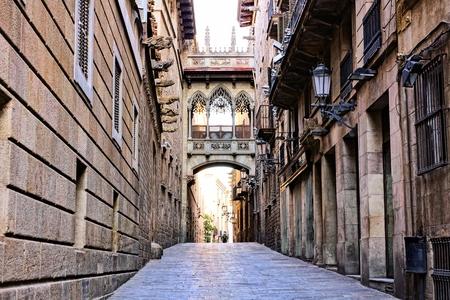 old quarter: Ornate covered bridge in the Gothic Quarter of old Barcelona, Spain Stock Photo