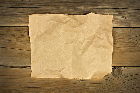 crumbled: Blank crumbled brown paper on a rustic wooden background Stock Photo