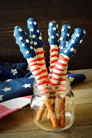 pretzel: Fourth of July American flag themed pretzel rods in a mason jar against rustic wood