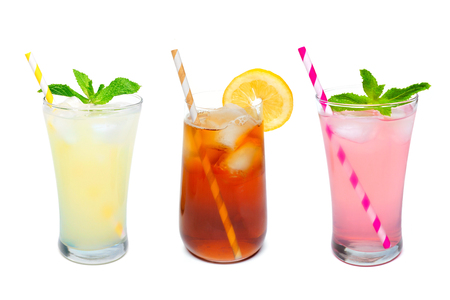 Three glasses of summer lemonade, iced tea, and pink lemonade drinks with straws isolated on a white background