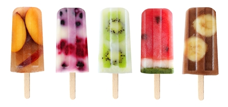 Five assorted fruit popsicles isolated on a white background