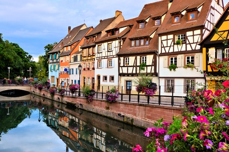 colmar: Beautiful canals of Colmar, France with late day reflections