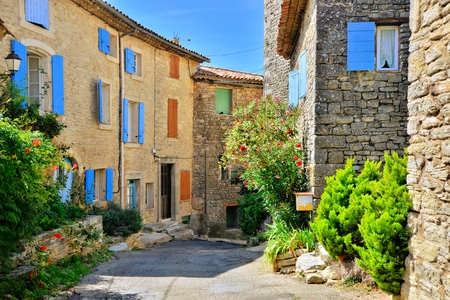 quaint: Pretty houses with colorful shuttered windows in a quaint village in Provence, France