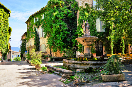 provencal: Leafy town square with fountain in a picturesque village in Provence, France Stock Photo