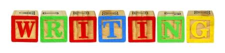 letter blocks: Wooden toy letter blocks spelling WRITING isolated on white Stock Photo