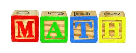 letter blocks: Wooden toy letter blocks spelling MATH isolated on white