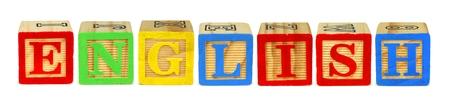 letter blocks: Wooden toy letter blocks spelling ENGLISH isolated on white