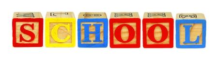 letter blocks: Wooden toy letter blocks spelling SCHOOL isolated on white