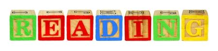 letter blocks: Wooden toy letter blocks spelling READING isolated on white