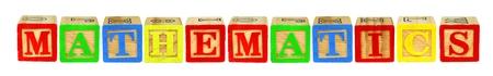 letter blocks: Wooden toy letter blocks spelling MATHEMATICS isolated on white