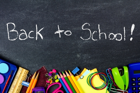 Back to School on chalkboard with bottom border of school supplies