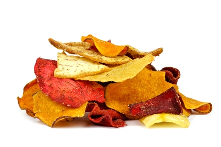 Pile of mixed healthy vegetable chips isolated on a white background