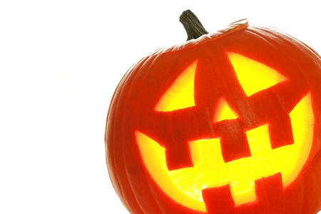 Halloween Jack o Lantern over a white background, close up in corner Stock Photo