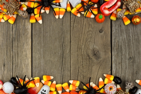 Halloween candy and decor double border against a rustic wood background Stock Photo