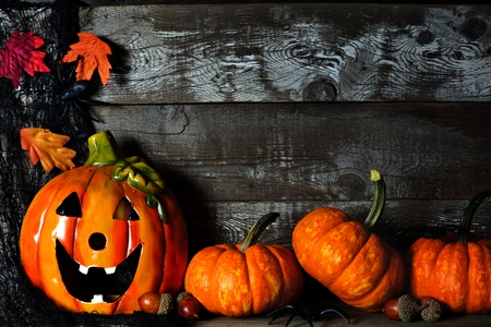 mini jack: Halloween Jack o Lantern at night with pumpkin corner border against a rustic old wood background