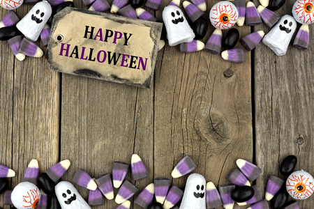 aged wood: Happy Halloween tag with candy double border against an aged wood background