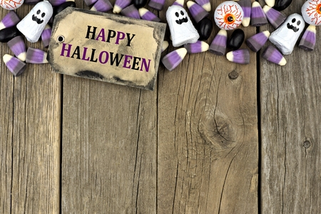 aged wood: Happy Halloween tag with candy top border against an aged wood background