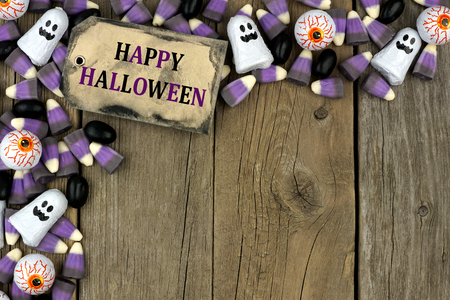 aged wood: Happy Halloween tag with candy top corner border against an aged wood background