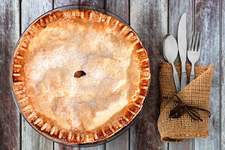 apple pie: Delicious autumn apple pie, overhead table setting on a rustic wood background Stock Photo