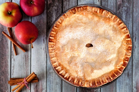baked: Delicious autumn apple pie, overhead table scene on a rustic wood background