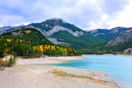 Peaceful lake in the Canadian Rocky Mountains during autumn