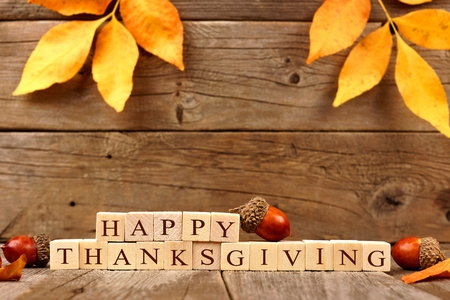 foliage: Happy Thanksgiving wooden blocks against a rustic wood background with acorns and autumn leaves Stock Photo