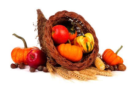 fruit basket: Thanksgiving cornucopia with pumpkins, apples and gourds isolated on a white background