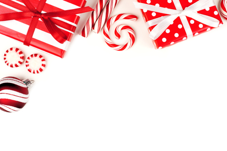 peppermint: Christmas corner border of red and white gifts and peppermint candies over a white background Stock Photo