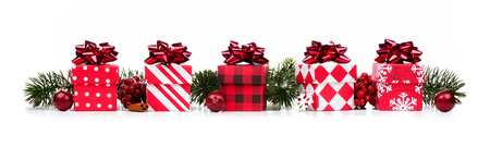Christmas border of red and white gift boxes and branches isolated on a white background Banque d'images - 116848510
