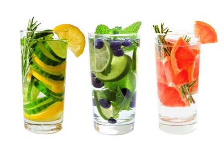 flavoured: Three types of fruit detox water isolated on white Stock Photo