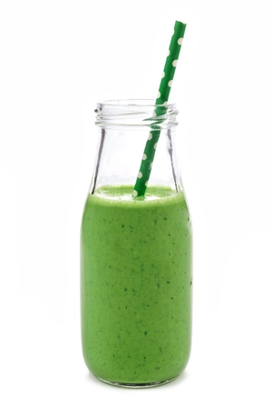 Green smoothie in a milk bottle isolated on a white background