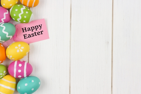 Happy Easter gift tag with colorful Easter egg side border against a white wood background