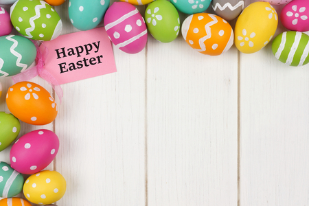 Happy Easter gift tag with colorful Easter egg corner border against a white wood background