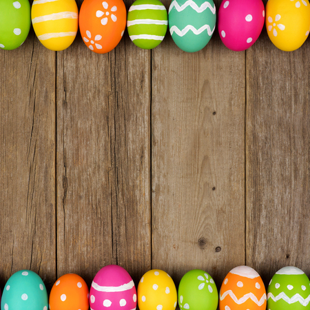 Colorful Easter egg double border against a rustic wood background