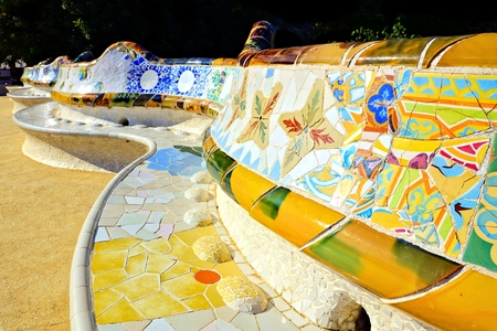 Colorful curving mosaic walls of Parc Guell, Barcelona, Spain