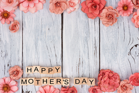 Happy Mothers Day wooden blocks with rustic paper flower double border on a white wood background