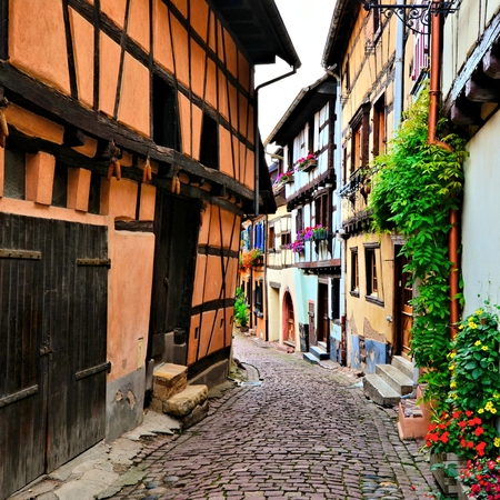 Beautiful colorful street in the of the town of Eguisheim, Alsace, France