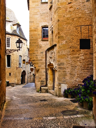 Medieval lane in the picturesque old town of Sarlat, Dordogne, France