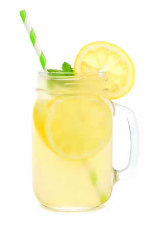 Mason jar glass of lemonade with straw isolated on a white background