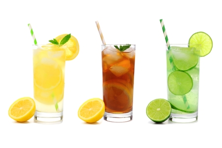 Three glasses of summer lemonade, iced tea, and limeade drinks with straws isolated on a white background Foto de archivo