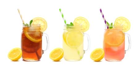 Three mason jar glasses of summer iced tea, lemonade, and pink lemonade drinks isolated on a white background 스톡 콘텐츠