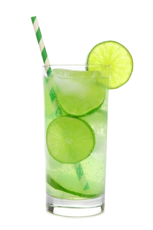 Glass of sparkling limeade with straw isolated on a white background Stock Photo