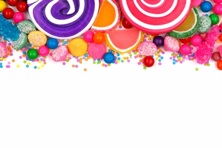 gumballs: Top border of an assortment of colorful candies against a white background