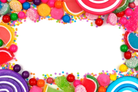 Frame of an assortment of colorful candies against a white background